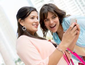 Girls using a smart phone sending a text message